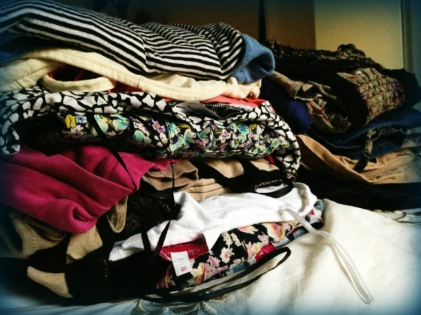 pile of maternity clothes