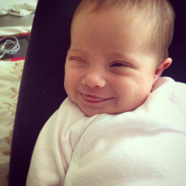 smiling winking baby