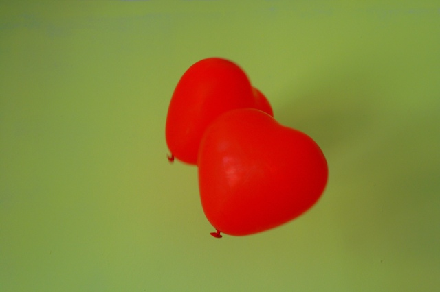 Two heart shaped red balloons